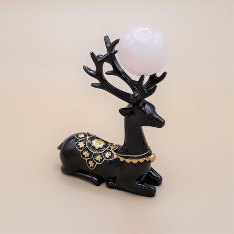 Ensemble sphère en pierre de Quartz rose et support en résine effigie Cerf noir et doré